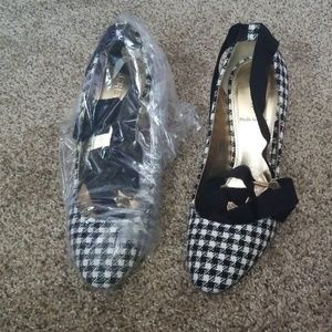 New in plastic black and white checkered heels